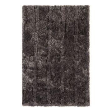 tapis shaggy uni noir pelle ligne pure