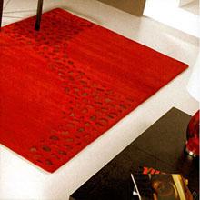 tapis loxton rouge à motifs en peaux carving