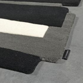 tapis design angelo en laine pebbles noir et blanc