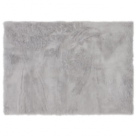 tapis fourrure gris clair