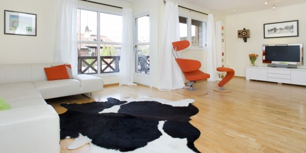 comment relooker son salon avec un tapis moderne. Black Bedroom Furniture Sets. Home Design Ideas