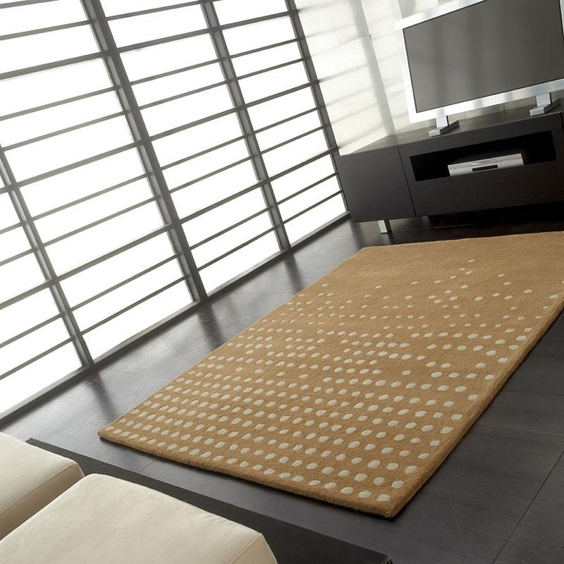 tapis pompoms cascatacarving en laine beige