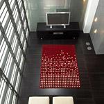 tapis pompoms cascata carving en laine rouge