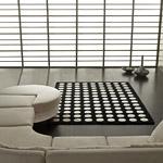 tapis pompons carving noir et blanc