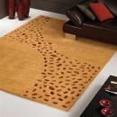 tapis loxton ocre à motifs en peaux carving