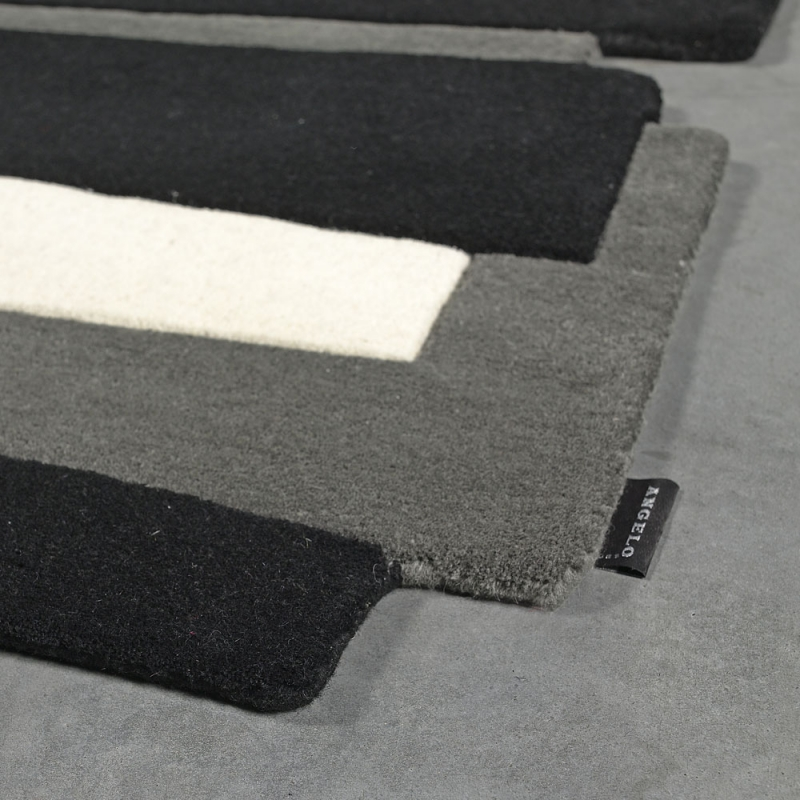 tapis design angelo en laine pebbles noir et blanc 140x200. Black Bedroom Furniture Sets. Home Design Ideas