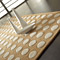 tapis pompons beige carving