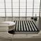 tapis pompons noir et blanc - carving