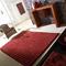 tapis tridimensional rouge en laine carving